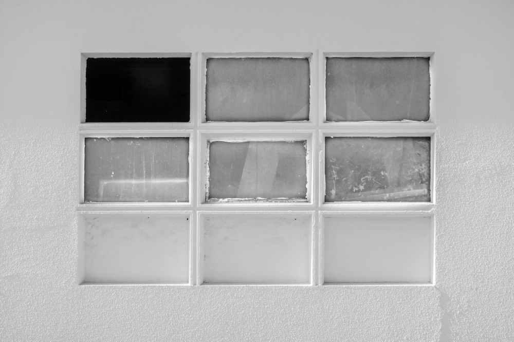 white framed glass window